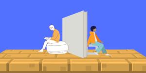 2 férfi háttal ül egymásnak, köztük pedig egy gipszkarton térelválasztó
